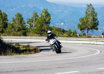 Cardona, Spain - October 29, 2016:  Motorbike coming out of a curve on a country road in Spain